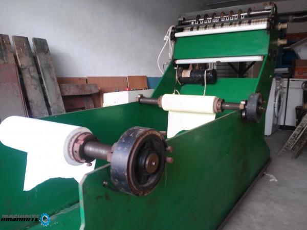 Машина за производство на ролки за касови апарати